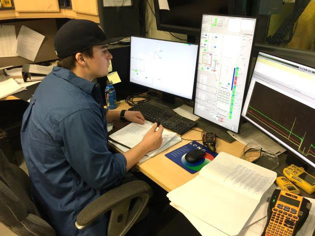An operator works on the facility's distributed control system.