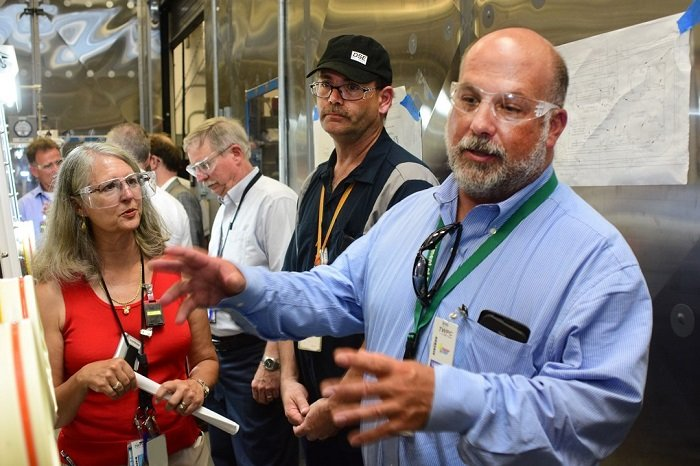 During his Oak Ridge visit, Jarrell, right, toured all EM-related projects and facilities, including the Transuranic Waste Processing Center. He met the employees who are processing and packaging waste for disposal at the WIPP near Carlsbad, New Mexico.