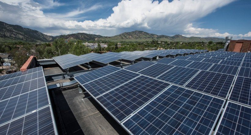Solar panel array with mountains in the background
