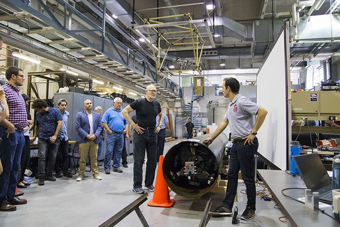 At right, Larry Papincak, a Carnegie Mellon University master's student in mechanical engineering, explains how PipeDream works to demonstration participants.