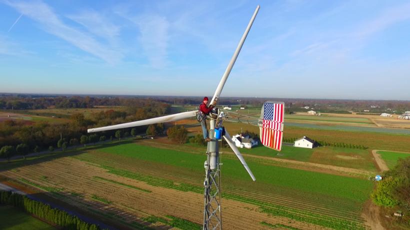 Technician working on a distributed wind turbine.