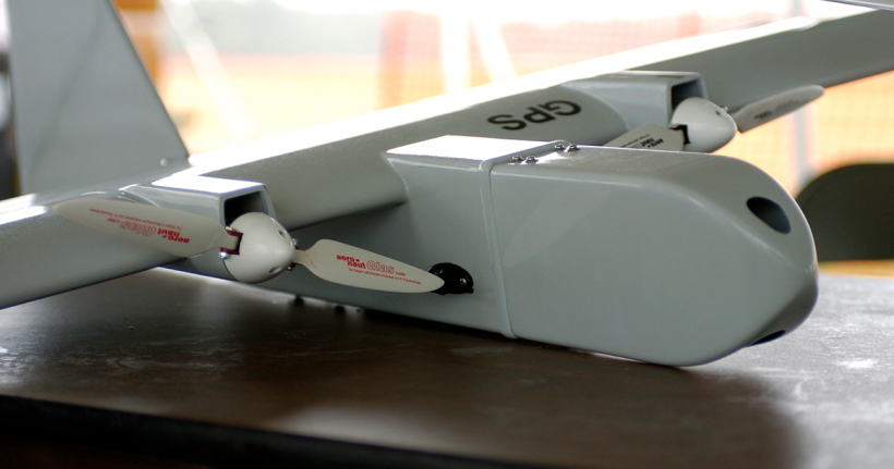 An unmanned aerial vehicle positioned on a table.