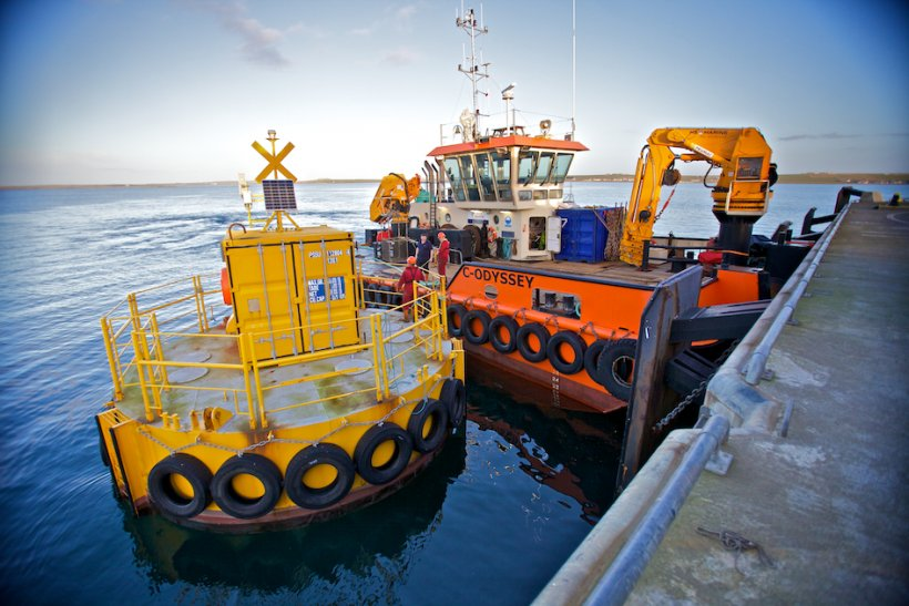 A rig prepares a test support buoy at the EMEC.