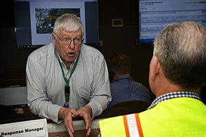 Fluor-BWXT Portsmouth's Bernard Carrick, left, takes part in a recent emergency exercise at the Portsmouth Site's Emergency Operations Center, which has been upgraded as part of the site's emergency preparedness activities.