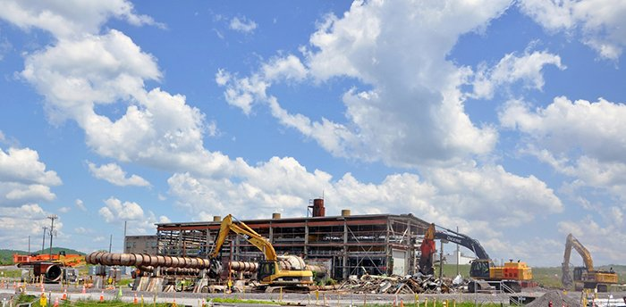 Equipment operators tear down the 18,100-square-foot contaminated facility located in the Poplar Creek area of the East Tennessee Technology Park.