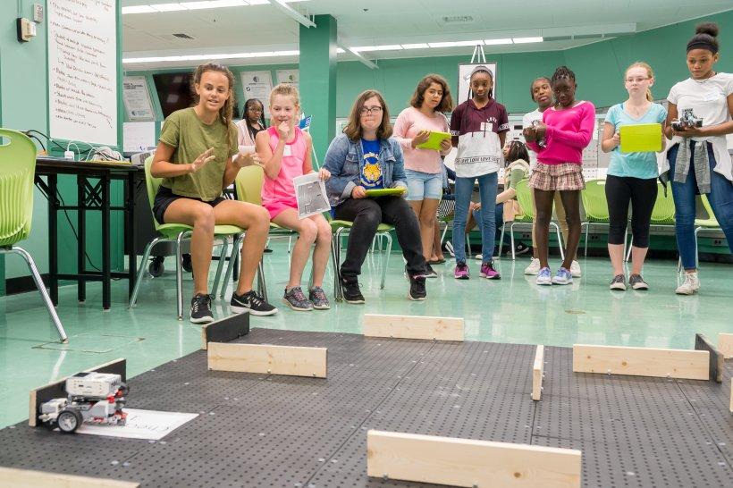 Participants in the CodeGirls@Argonne camp test their code by maneuvering a robot through a maze.