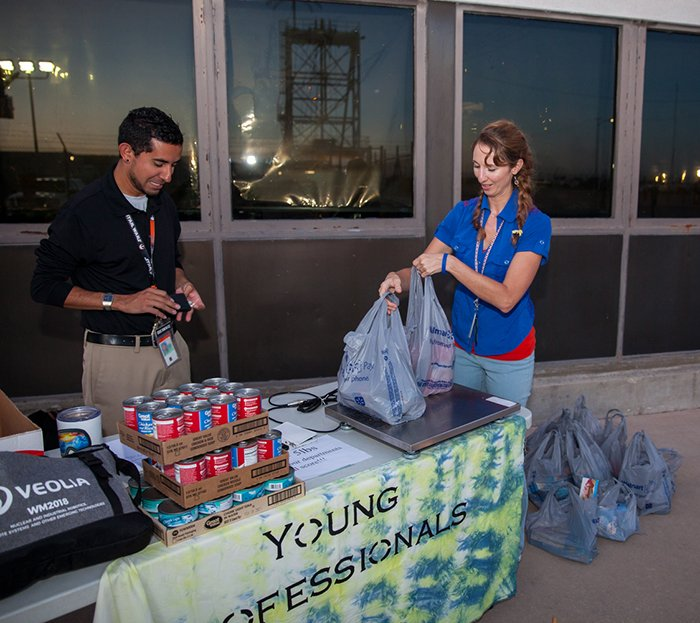 Chris Dominguez and Sheree Turner of the Waste Isolation Pilot Plant Young Professionals group volunteer at a food drive.