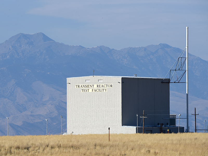 Exterior photo of a feature at the TREAT reactor, with mountains shown in the background.