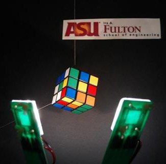 Photo of white OLEDs illuminating a Rubik's cube.