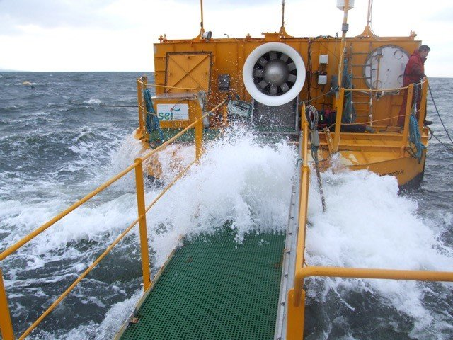 Photo of a platform leading to a buoy in rough seas.