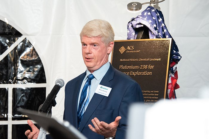 Mike Budney, manager of DOE's Savannah River Site Operations Office, accepts a commemorative plaque recognizing the Savannah River Site's role in the production, separation, and supply of plutonium-238.