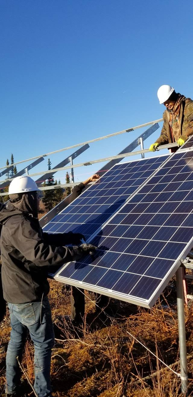 Alaska crew installing solar panels.