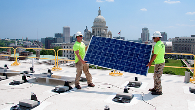 Photo of two men with solar panels.