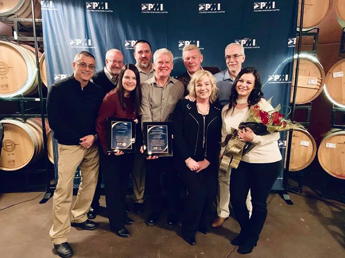 Employees with CH2M HILL Plateau Remediation Company hold the awards they received from the Columbia River Basin Chapter of the Project Management Institute. From left, Jeff Broussard, Dan Wood, Ketra Evans, Matt St Germaine, Neal Sullivan, Ty Blackford,