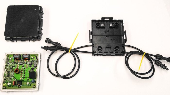 Clockwise from top left: the vBoost converter cover plate, the frame to attach to the PV module, and the circuit board. Photo courtesy of eIQ Energy.