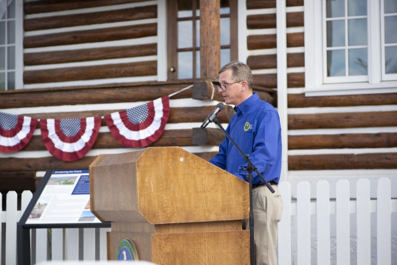 Padraic Benson emcees the opening ceremony of the Atomic Legacy Cabin.