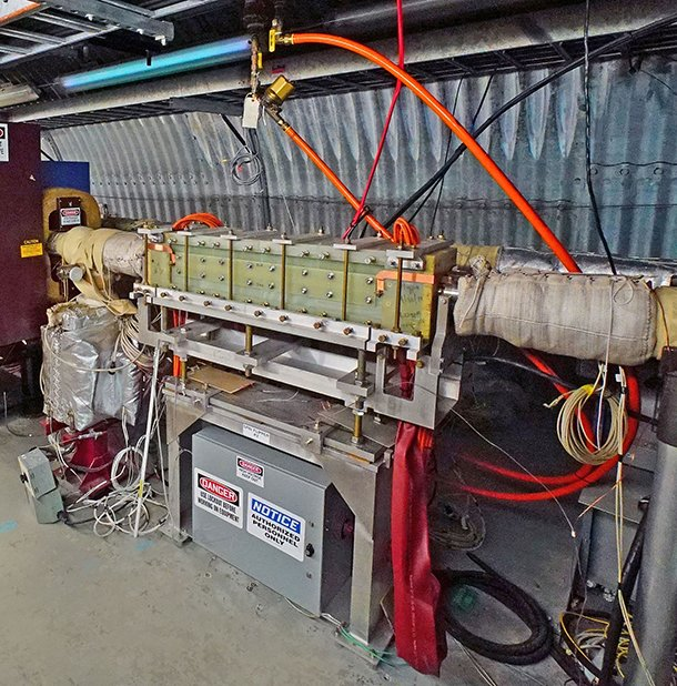 The spin flipper magnet assembly resides inside a tunnel that houses the Relativistic Heavy Ion Collider at Brookhaven National Laboratory.