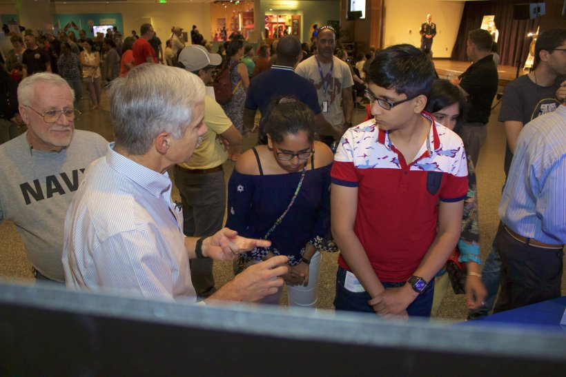 Dr. Steve Azevedo explaining Lawrence Livermore National Laboratory's technologies to museumgoers during Military Invention Day at the National Museum of American History.