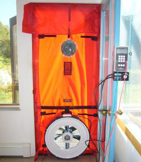 Equipment attached to the wall of a home to analyze air control.