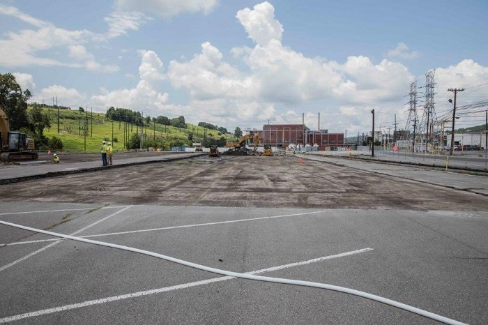 Workers remove asphalt on the east end of the Y-12 National Security Complex for the site of the Mercury Treatment Facility's treatment plant.