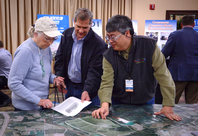 A DOE contractor discusses the Portsmouth On-Site Waste Disposal Facility with local residents during a community Open House event.