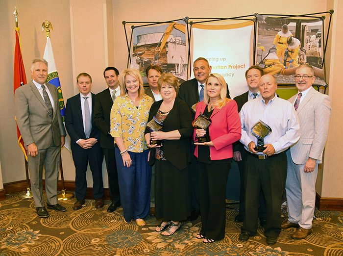 UCOR President and CEO Ken Rueter, far left, and EM's Ike White, second from left, join representatives of the UCOR Small Business Award winners.