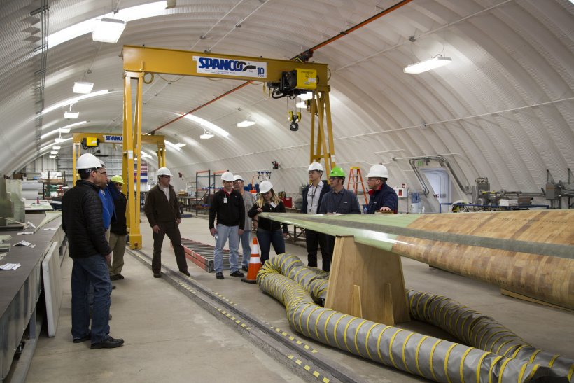 People standing in the National Wind Technology Center.