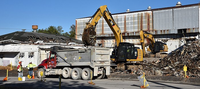 Oak Ridge crews remove debris from the K-1004-J Lab demolition, which began earlier this month.