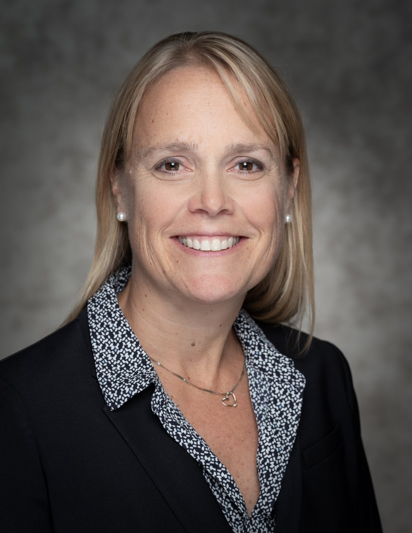 Head and shoulders portrait of Christy Cooper, Acting Business and ITSO Director.