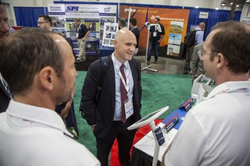 Daniel Simmons speaks to a member of the Phase 3 Photovoltaics Solar Prize winning team.