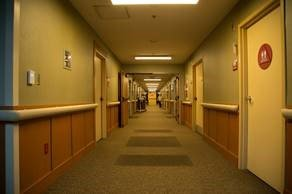 A nursing-care center hallway at night, with lighting dimmed to 20% output.