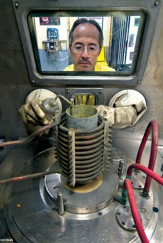An employee at Los Alamos National Laboratory prepares to cast plutonium.