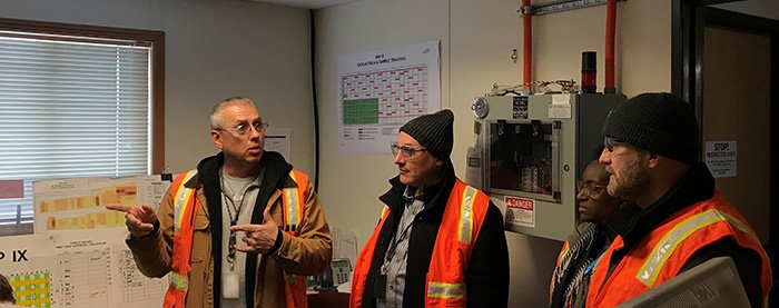 Jim Southwick, Fluor Idaho nuclear operations manager for the Accelerated Retrieval Project, discusses EM's targeted buried waste exhumation mission at the Radioactive Waste Management Complex with Mahmoud Karam of Canadian Nuclear Laboratories.