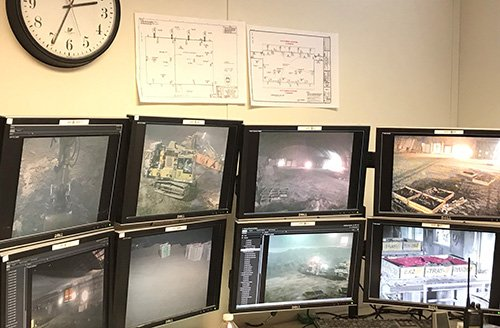 Operators monitor all facets of the Accelerated Retrieval Project through closed-circuit monitors.