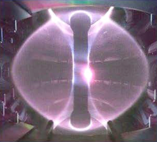 Image of the inside of a magnetic confinement experiment during plasma discharge.