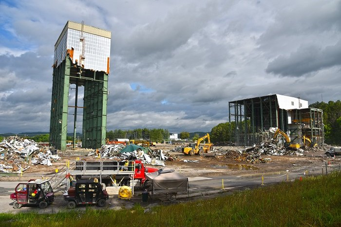 A view of the last remaining portions of Oak Ridge's once sprawling Centrifuge Complex are shown here before crews pulled down the 180-foot tower, at left. Workers will now focus on removing the debris and finalizing demolition on the K-1210 complex, at r
