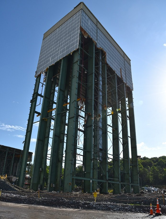 Workers used powerful winches to pull down the steel beams of the 180-foot tower of Building K-1220 at Oak Ridge.
