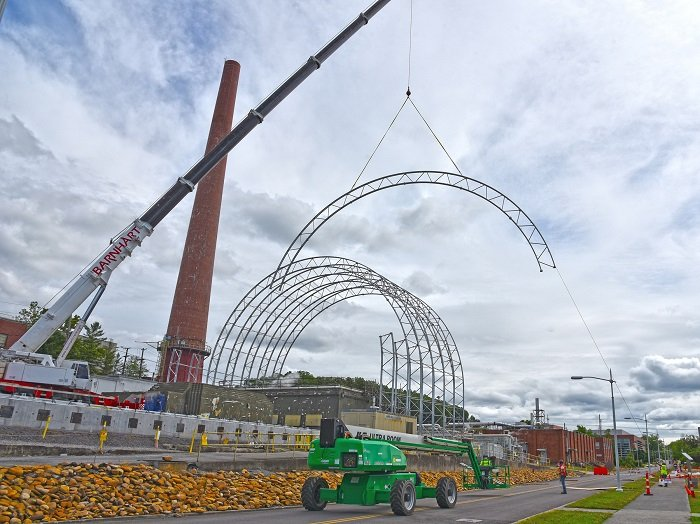 A 175-ton crane is being used to install a six-story protective cover to keep research facilities near Building 3026 safe during demolition.