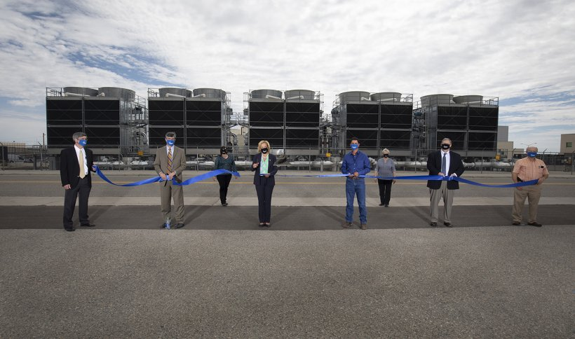 Former NNSA AdministratorLisa E. Gordon-Hagerty, accompanied by NNSA's partners from Los Alamos National Laboratory, cuts the ribbon for the Exascale Class Computer Cooling Equipment Project.