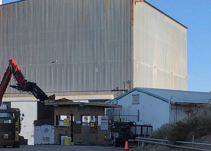 Workers have begun demolition at the Radioactive Materials Handling Facility complex at the Energy Technology Engineering Center.
