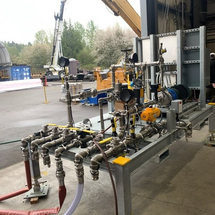 A factory acceptance test for a Savannah River Remediation equipment procurement was completed remotely instead of in-person at the manufacturer's site due to COVID-19 travel restrictions.