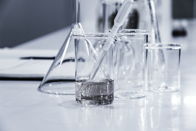 Laboratory equipment on a clean table.