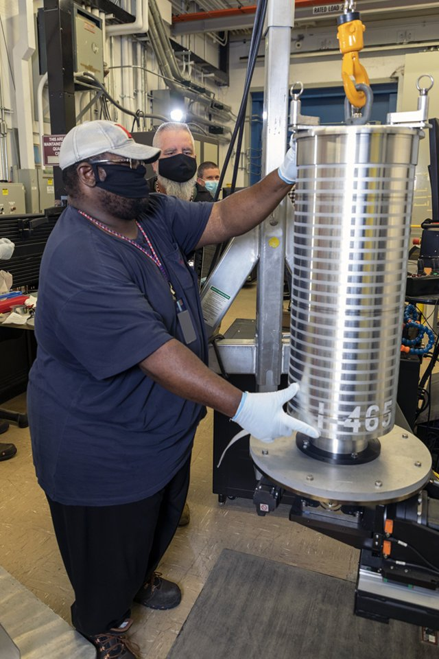 Y-12 National Security Complex Material Clerk Kenny Blakely positions an inner fuel element so it can be secured for computed tomography scanning.