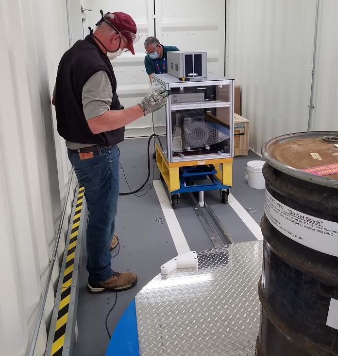 Characterization equipment operators Tim Carlton, left, and Todd Shepley perform a virtual equipment test.
