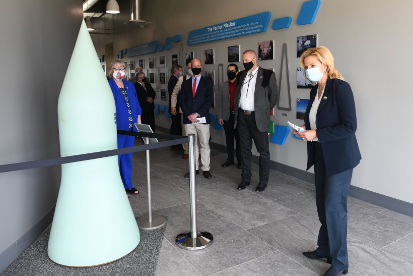 """From left, Consolidated Nuclear Security President Michelle Reichert, U.S. Rep. William """"Mac"""" Thornberry, Pantex graphic artist Deron Lucero, NNSA's Geoff Beausoleil, and NNSA Administrator Lisa E. Gordon-Hagerty tour the new Pantex history display."""
