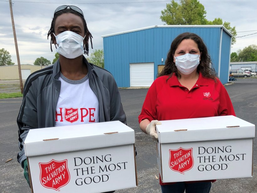Salvation Army employees Jeffrey English and Mindy Reid distribute food boxes curbside to limit contact during the pandemic.
