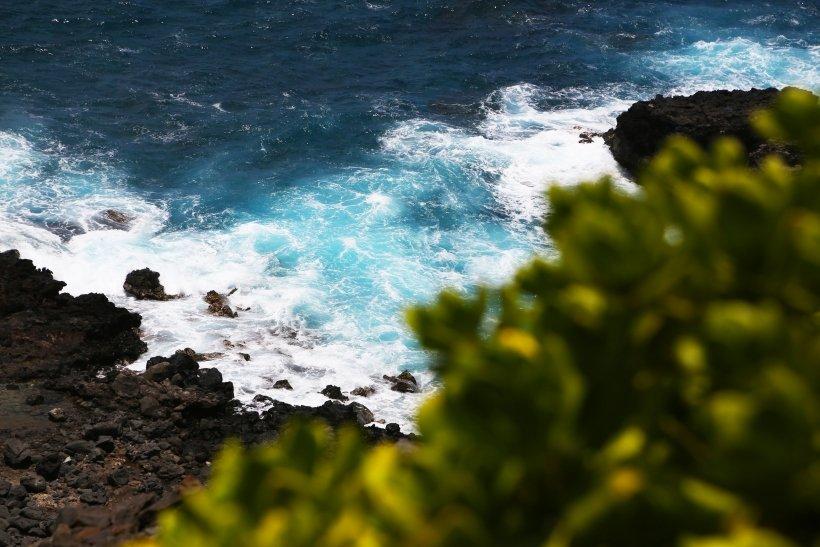 Ocean crashing against rocks.