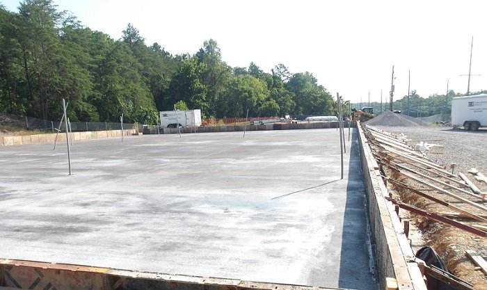 Site preparation for the Sludge Processing Mock Test Facility began in January 2020. Crews recently poured the concrete slab for the structure, which is slated for completion in October 2021.