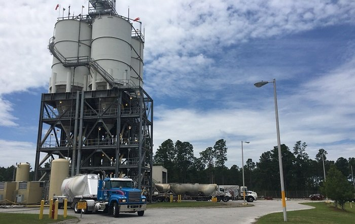 Recent facility upgrades make it possible for three trucks to simultaneously unload cold feed materials at the Saltstone Production Facility at the Savannah River Site.