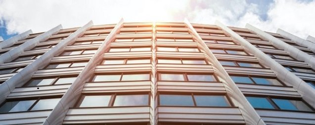 Exterior of a high-rise commercial building, at an angle looking up.